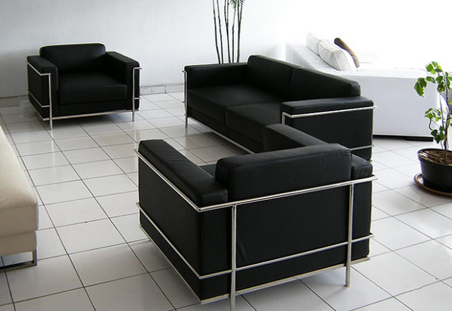 modern leather and stainless armchair and multi seat sofa
