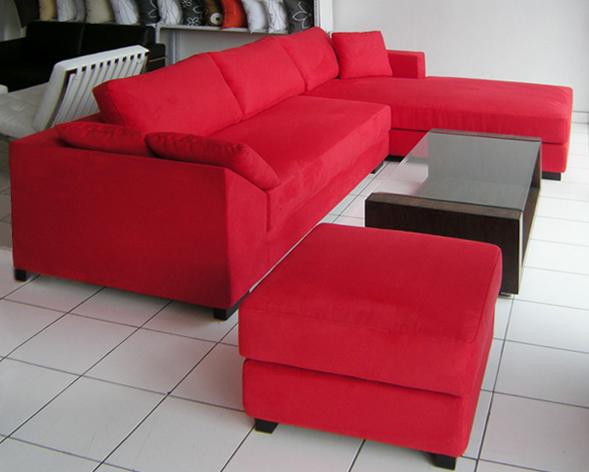 Red set sofa and puff made from microfiber with a glass coffee table