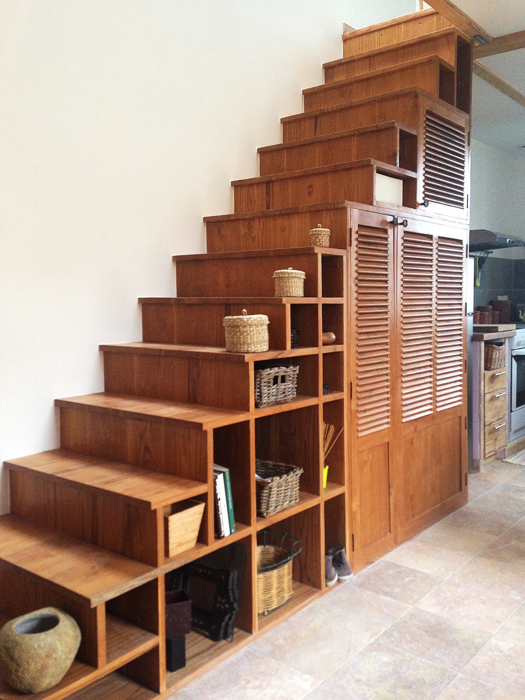 teak wood stairs and storage cabinet