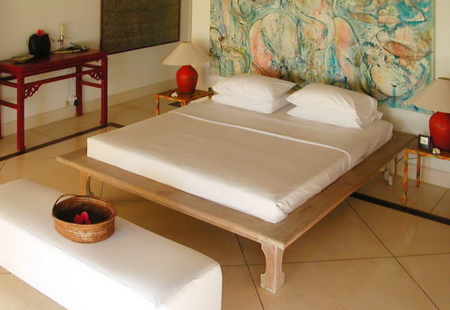 Minimalist bed made from teak wood