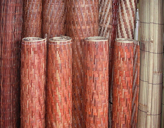 Handicraft carpet in tree skin and rattan