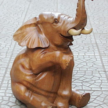 Suar wood carved of a sitting elephant. Handicraft from Bali