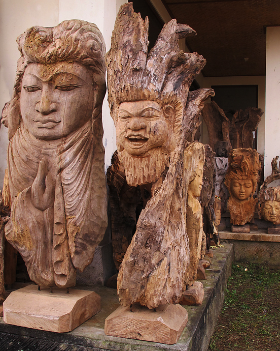 Buddha Statue on stand carved in Wood. Handicrafts from Bali