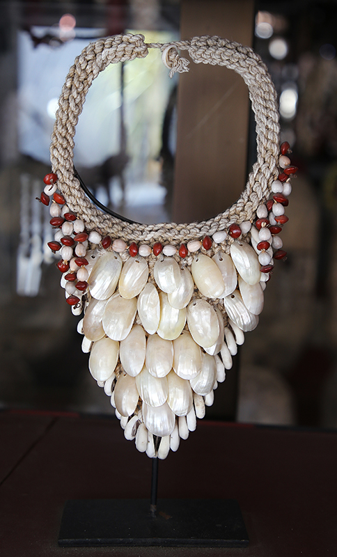 Primitive art and decoration from Indonesia. Papue shell necklace on stand