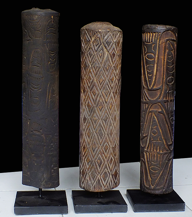 Primitive art and decoration. Musical Instruments from Papua new guinea. Digeridu wood carved.