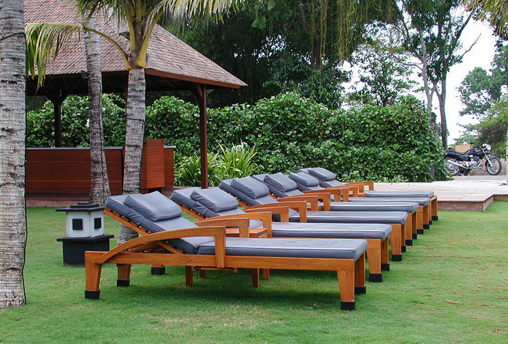 Teak wood sunbeds with sumbrella cushions