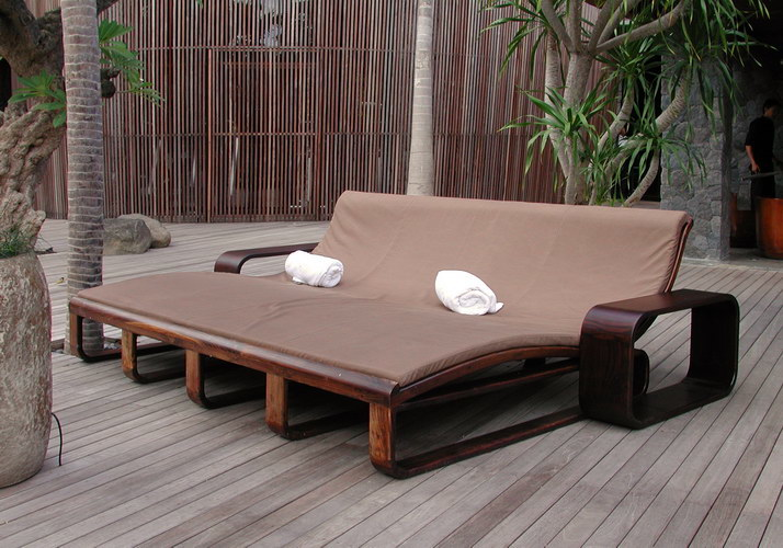 triple sunbed made from teak wood with sumbrella cushions