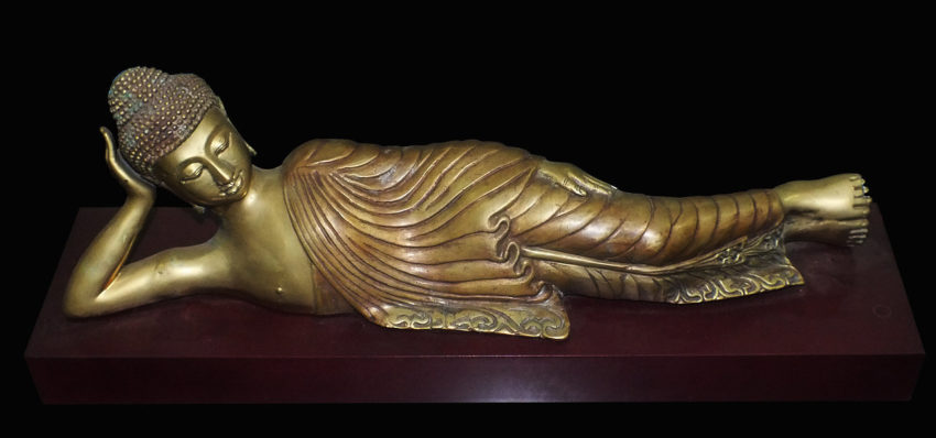 Brass sleeping buddha on base