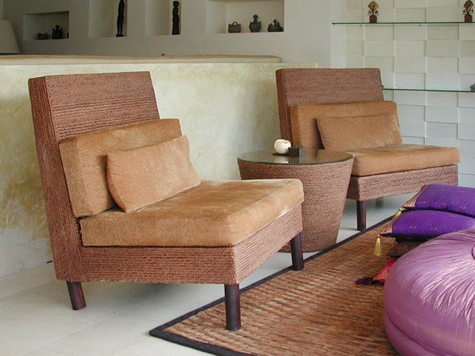Rattan Woven Lounge set arm chair with conique coffee table. Microfibre cushion and handmade furniture from Bali
