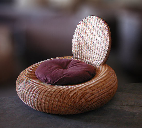 Rattan woven round lounge chair with cushion. Handmade furniture from Bali