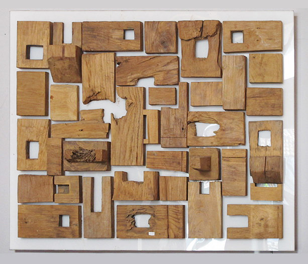 Wall decoration composed of old natural teak pieces