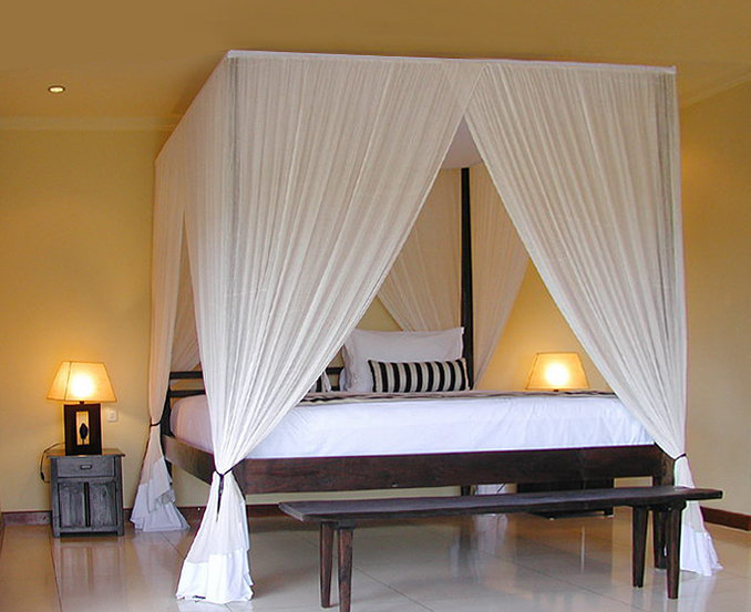 teak canopy bed with mosquito net with bench and antique style decoration