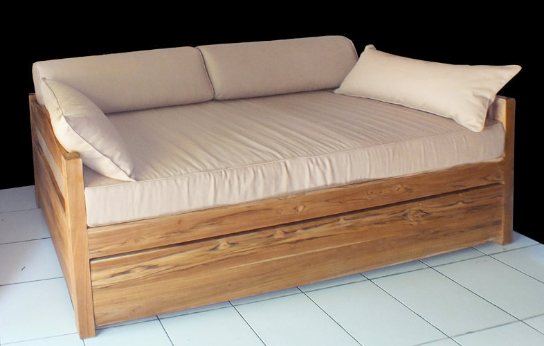 convertible teak bed natural finish with cotton mattress and cushioin decoration. modern style furniture