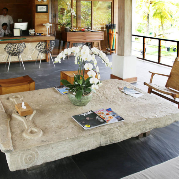 stone table look with teak chairs