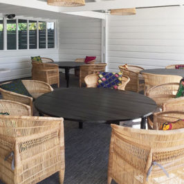 Old Javanese round teak table with rattan chairs from Bali