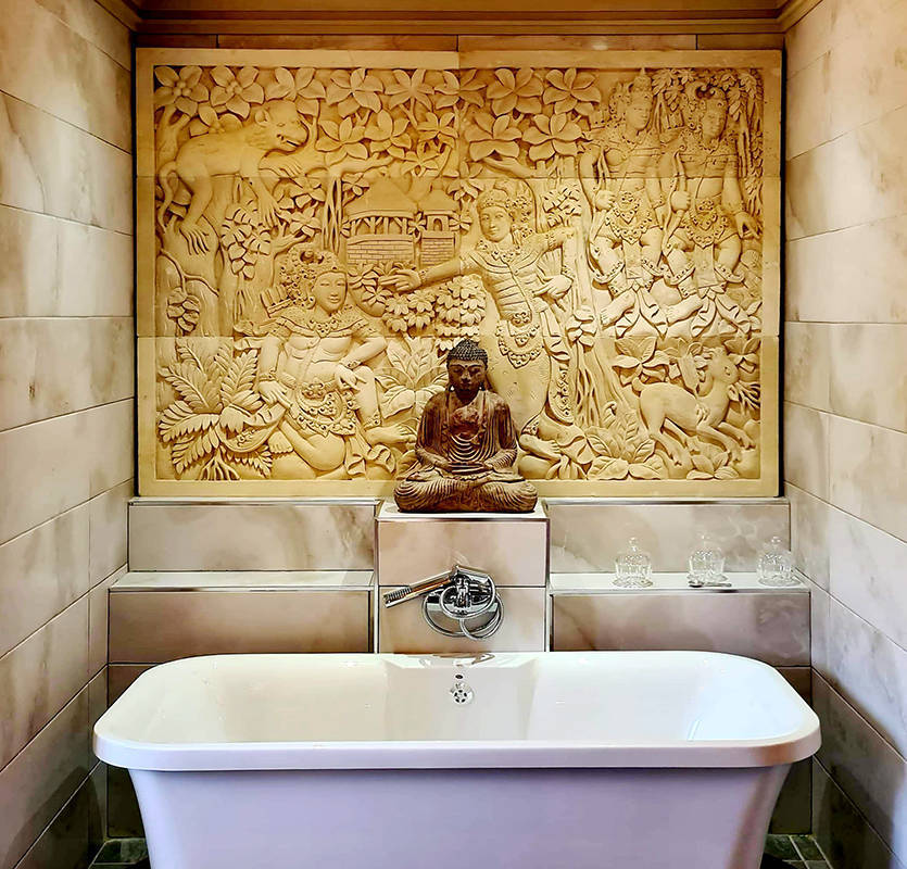 Bathroom decoration asian style with bathtub and buddha statue