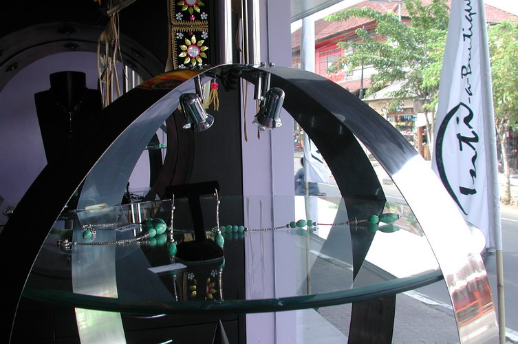 creative way to display jewelry in spherical stainless steel with glass and lamp