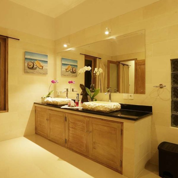 Bathroom furniture from teak and sink from stone