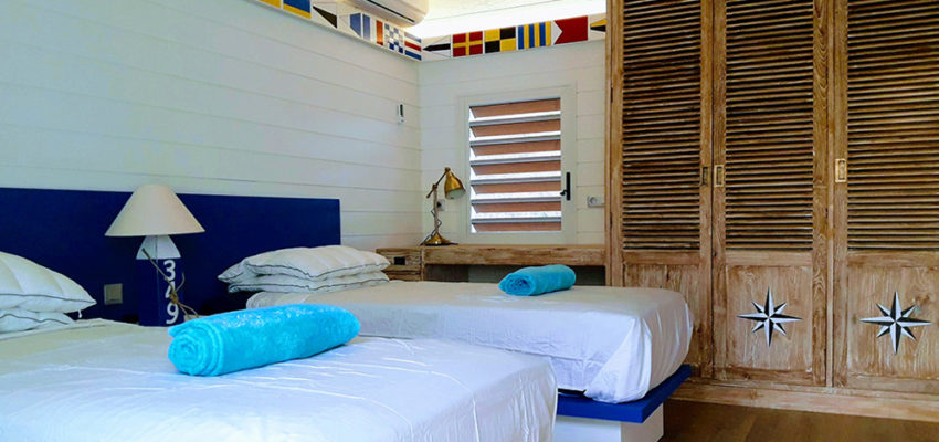 single beds made from mahogany for villa new caledonia side view