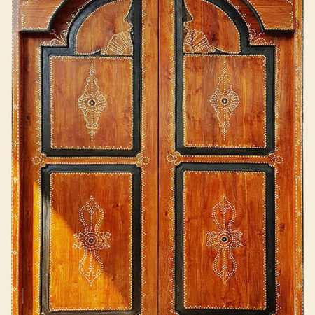 Double hardwood lombok entry door decorated with geometric shell pattern calls Cuklir Bayu International Trading Bali Indonesia