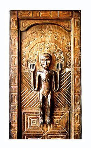 Primitive light wood door with carved statue timor Bayu International Trading Bali Indonesia