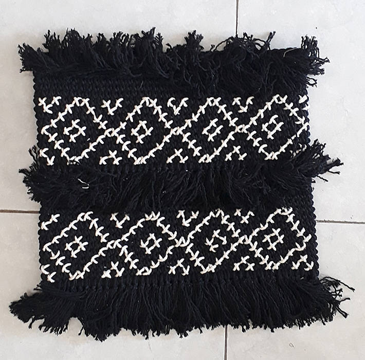 black rug with white pattern in diamond squares