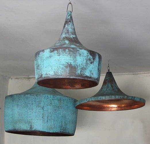 oxidised copper lamp hoods in different shapes and sizes