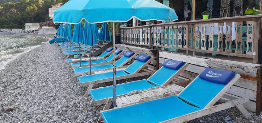Sunbeds and parasol in blue