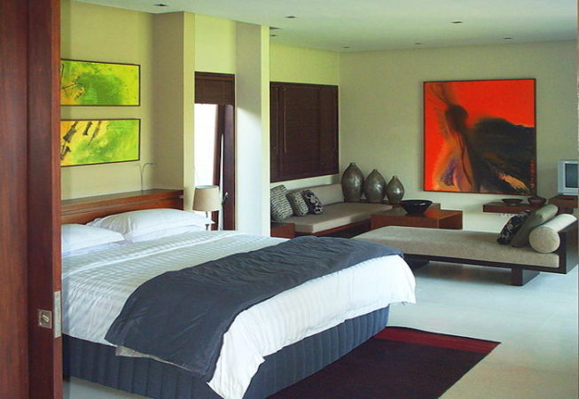 Complete decorated bedroom with painting,bed and furniture