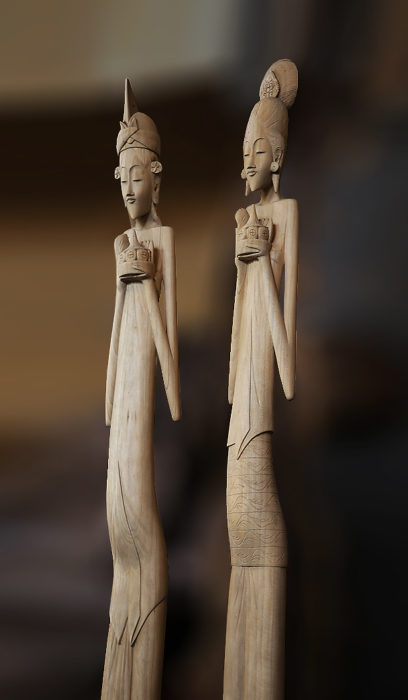 Long Balinese couple carved in Wood. Handicrafts from Bali