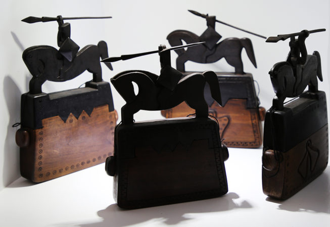 Carved wood sumba box with rider on top. Art and decoration from Indonesia.