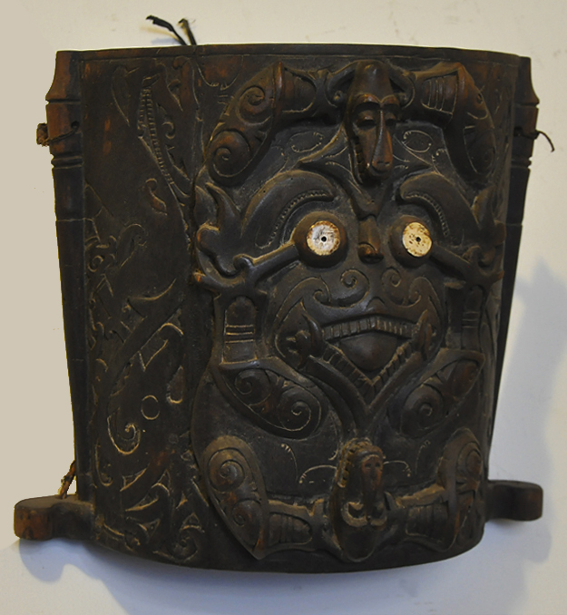 Primitive art and decoration from Indonesia. Hood for infants sculpted in iron wood dayak kalimantan.
