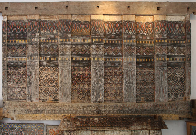 Primitive art and decoration from Indonesia. Old carved wood panel from House Toraja Sulawesi Indonesia.