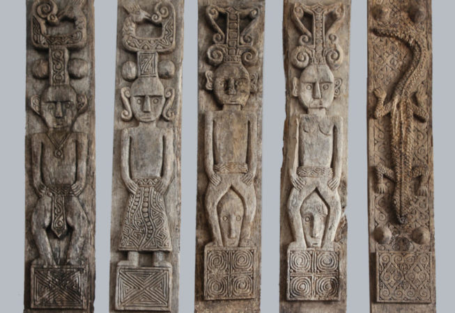 Primitive panel from Timor. Panel of men standing. Art and decor from Indonesia.
