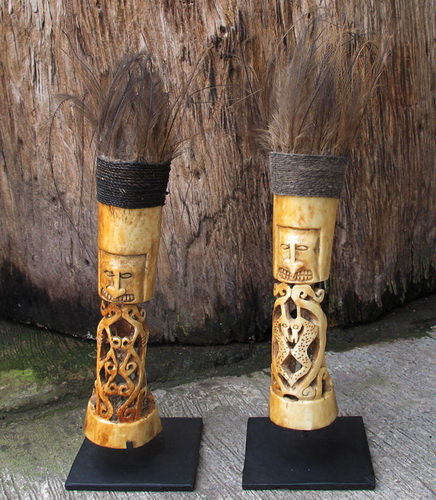 Small carved bone primitive kowar statue with feather casoar indonesia. Art and decoration.