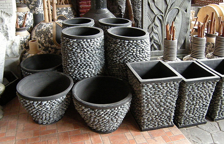 grey cement garden pots decorated with pebble