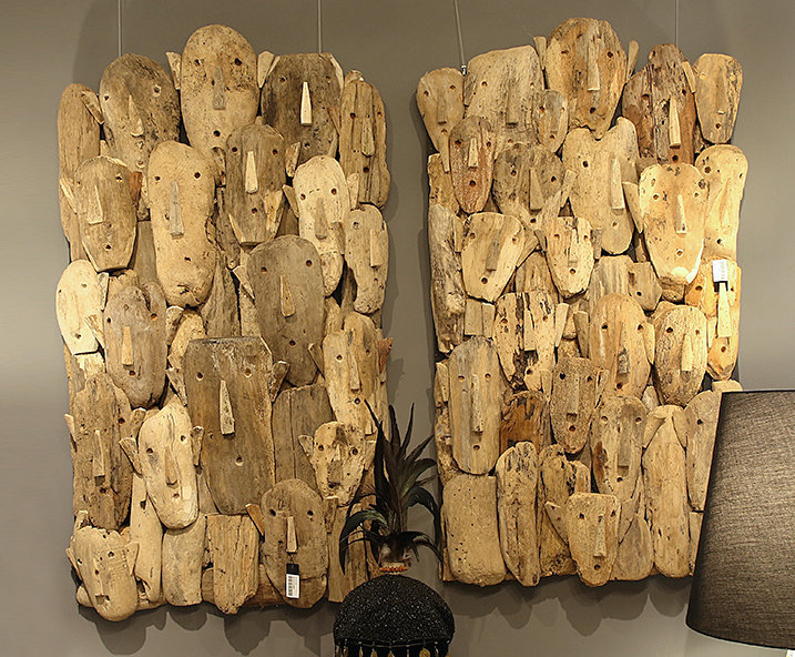 Wall decoration composed of small natural teak masks