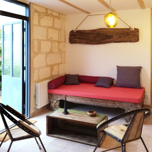 iron tubing chairs and teak sofa with red sumbrella