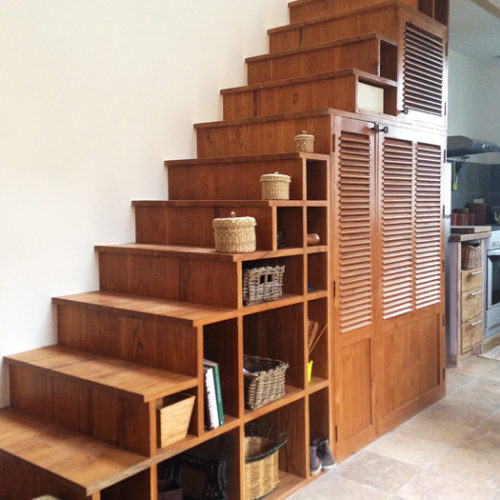 teak wooden staircase with storage compartments