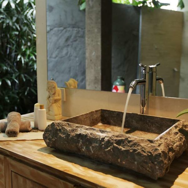 Bathroom sink made from stone and hospitality supplies