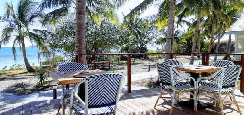 Outdoor villa furniture, arm chairs and a table on decking