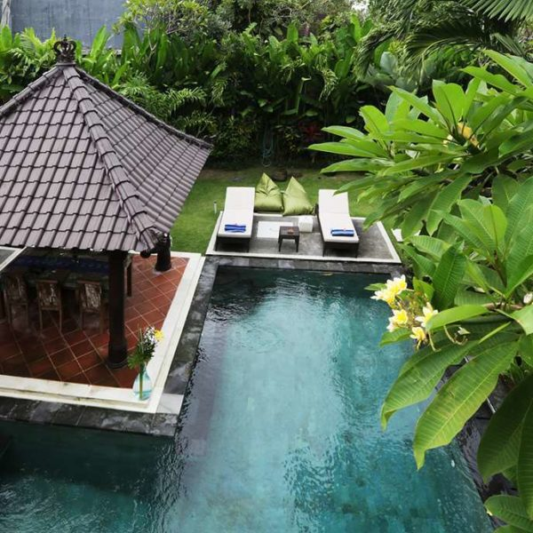 View from top to villa swimmingpool with sunbed and gazob by bayu international trading