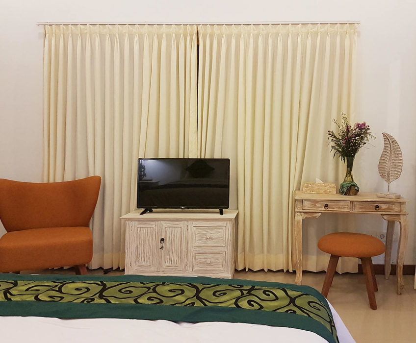 TV Furniture and desk made from Teak Wood. Arm chair and stool available as well in the room