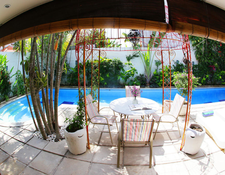 bamboo roll blinds and outdoor furniture set next to the swimming pool