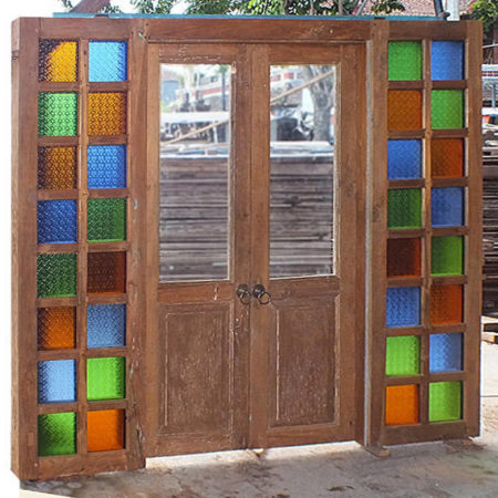 Old Javanese teakwood double door entrance with mosaic glass on each side of the frame Bayu International trading Bali Indonesia