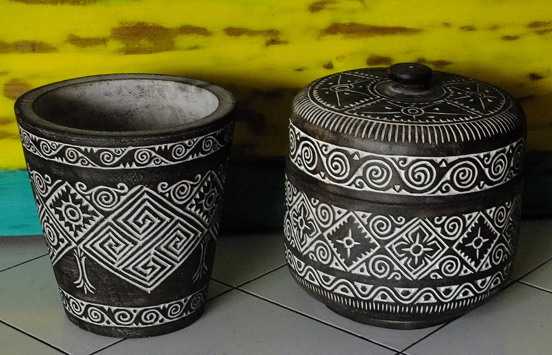 pots with decorative carvings from Indonesia